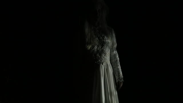 Witch in white dress One woman, she masked herself in a scary witch for halloween, standing in front of a car. ghost stock videos & royalty-free footage