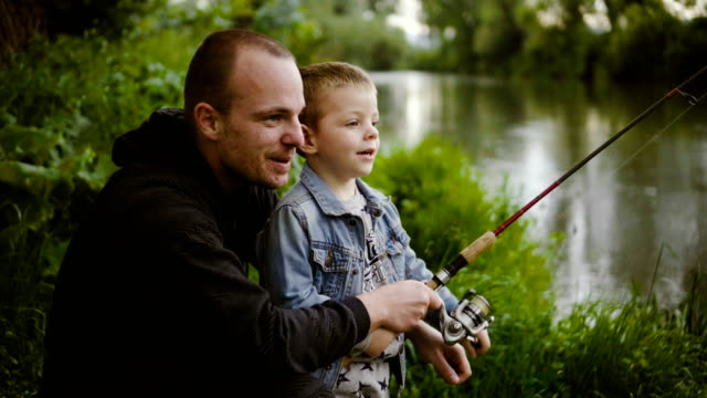With father on fishing Father is teaching his little son to fish. hobbies stock videos & royalty-free footage