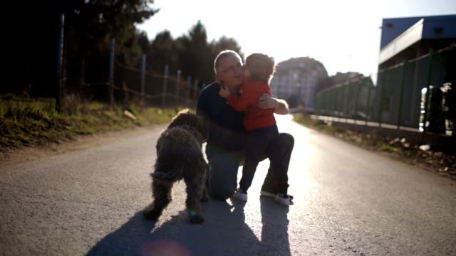 with my grandpa and our dog - внук стоковые видео и кадры b-roll
