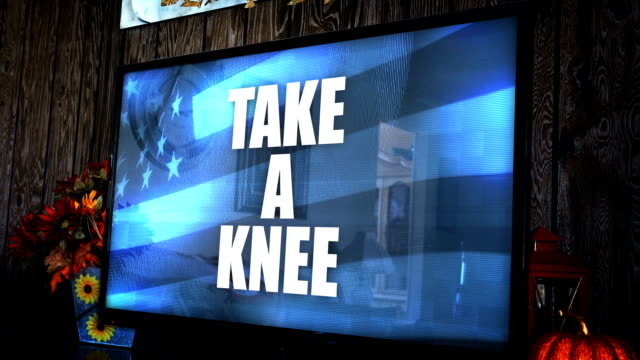 TV with ominious controversial news headline - Take a Knee video
