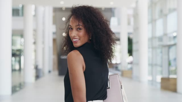 With the right attitude you can conquer the day 4k video footage of a young beautiful businesswoman in a modern office charming stock videos & royalty-free footage