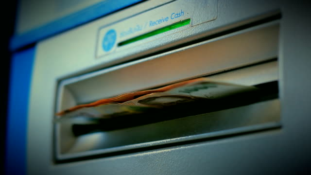 withdraw cash from atm - banks and atms stock videos & royalty-free footage