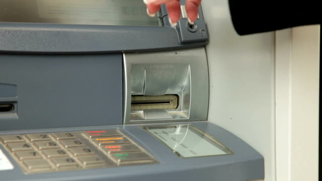 withdrawing money from atm machine - banks and atms stock videos & royalty-free footage
