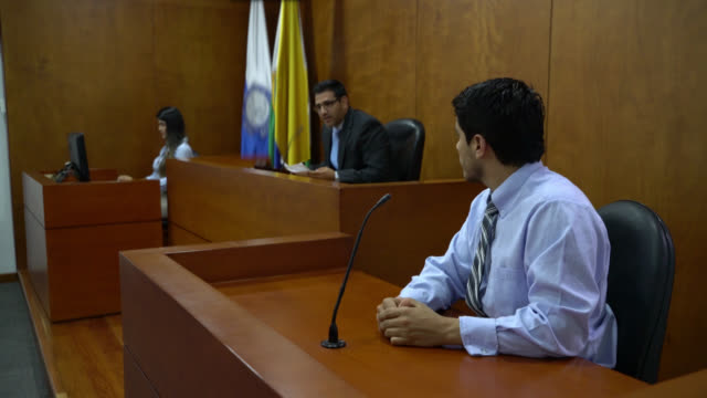 Witness at the court answering questions to the lawyer and judge video
