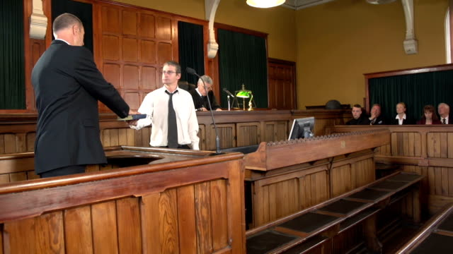 Witness taking oath in Courthouse with Judge (Law) video