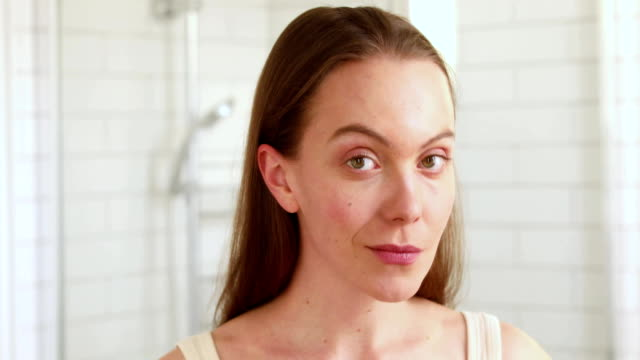 Woan touching her face enjoying her clean skin video