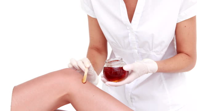 Woman about to get legs waxed video