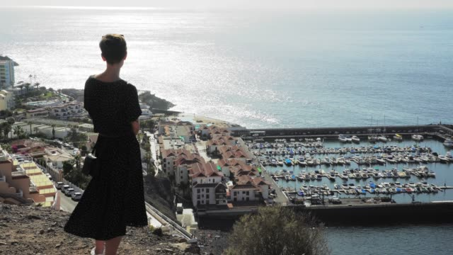Woman admiring landscape of Tenerife. City panorama