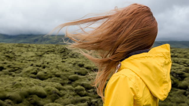 Woman admiring mossy landscape video