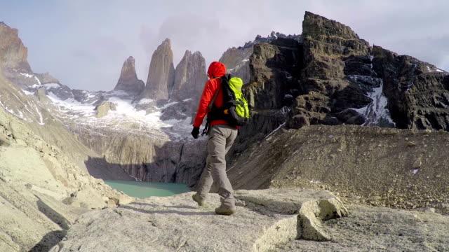 Woman admiring Torres del Paine peak