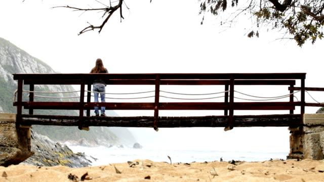 Woman alone on a winter coast video