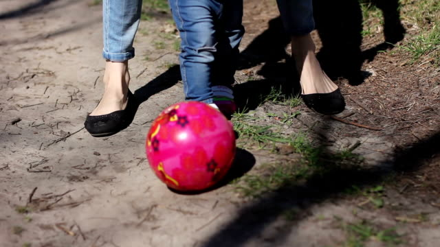 woman and girl play with ball in park video