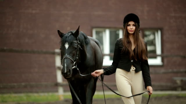 Woman and Horse in Riding School