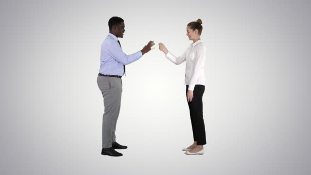 woman and man doign the paper, scissors, rock game on gradient background - forbici video stock e b–roll