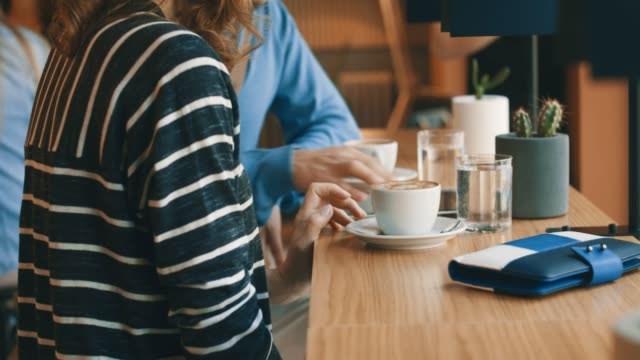 woman and man using digital tablet in cafe - caffetteria video stock e b–roll