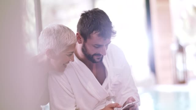 Woman and man using mobile at spa