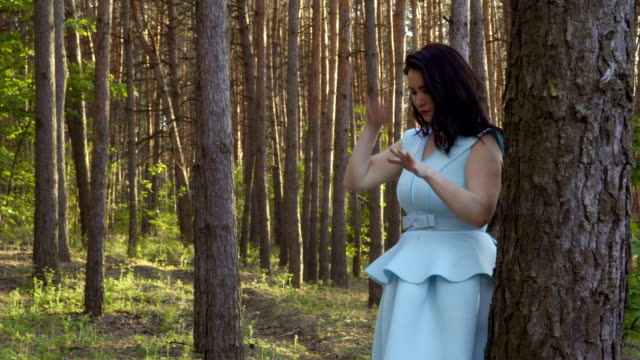 Woman and mosquitoes in the forest video