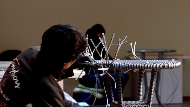 Woman and rattan manufacturing video
