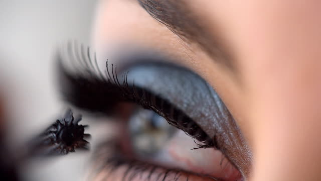 woman applying mascara on eyelashes - make up stock videos & royalty-free footage