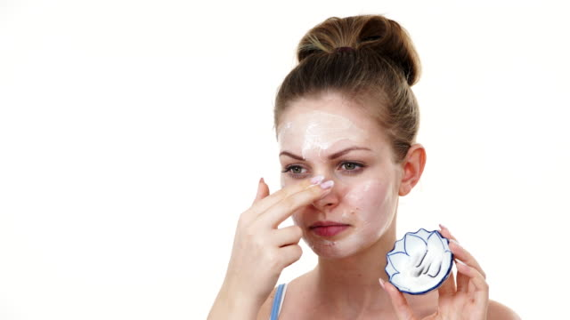Woman applying mask cream on face Woman applying mask cream on face. Body care and beauty lip balm stock videos & royalty-free footage