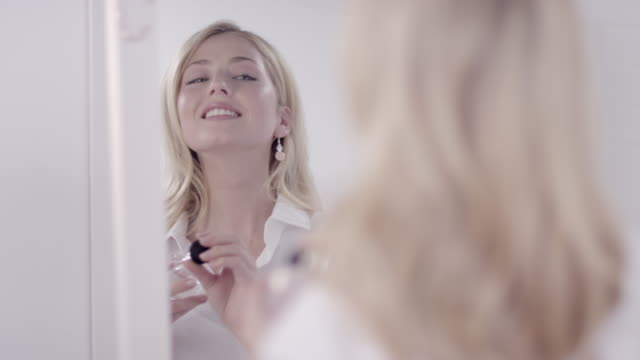 Woman applying perfume video