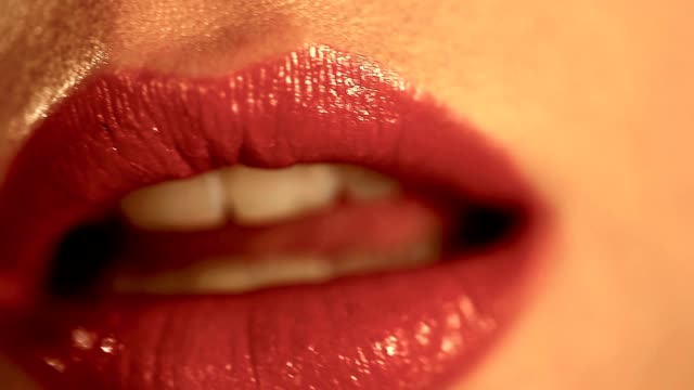 woman applying red lipstick macro close up sexy beauty lips makeup Detai