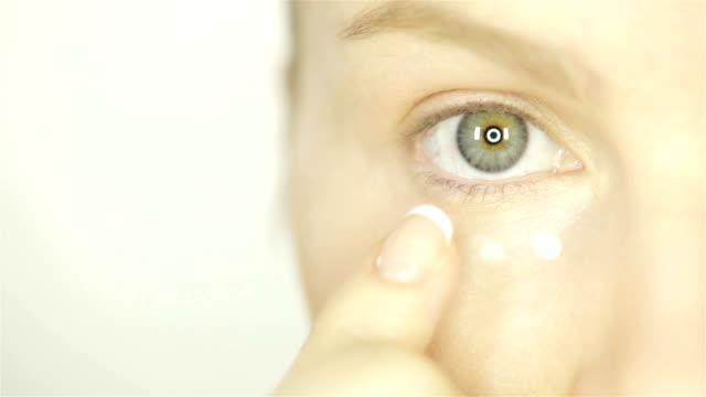 Woman Applying Skin Cream Under Eyes video