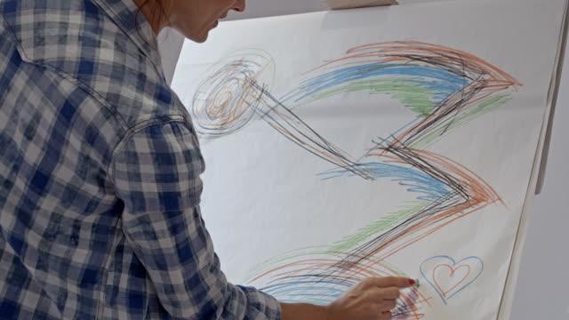 Woman artist drawing in art studio video