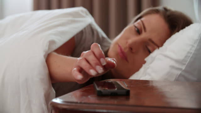 Woman Asleep In Bed Woken By Alarm On Mobile Phone video