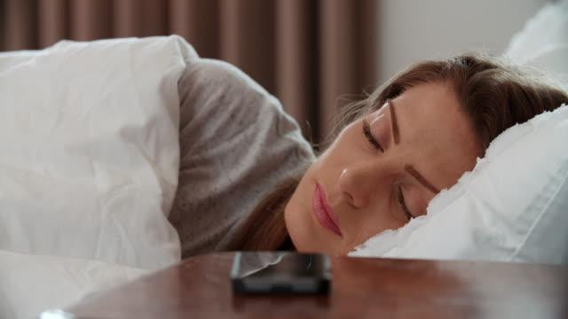 Woman Asleep In Bed Woken By Alarm On Mobile Phone video
