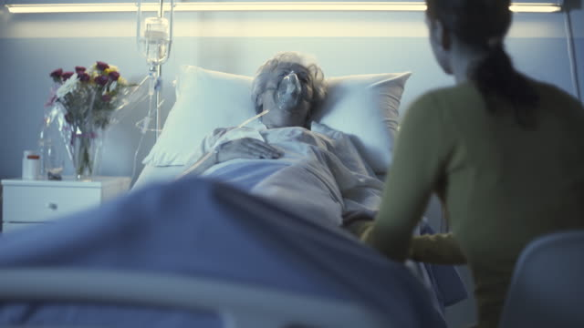 Woman assisting her sick mother at the hospital