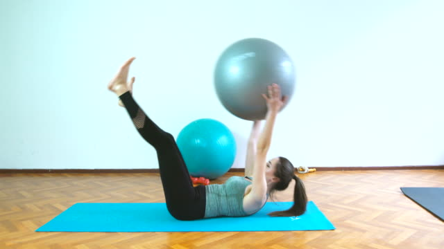 Woman at 20s with sexy body exercising with pilates ball video