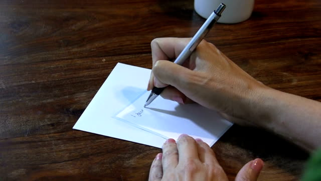 woman at a desk writing a thank you note - thank you stock videos and b-roll footage