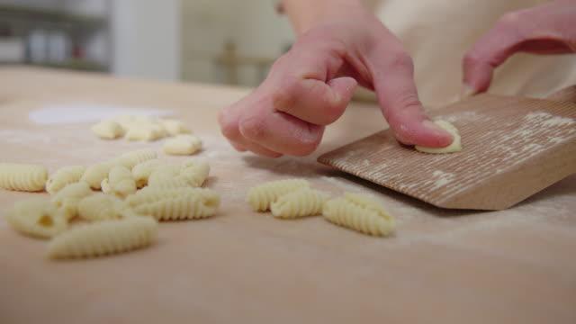 Woman at cooking workshop making pasta