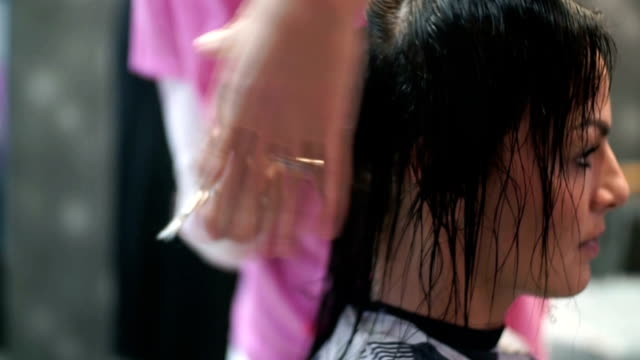 Woman at hairdressing salon. video