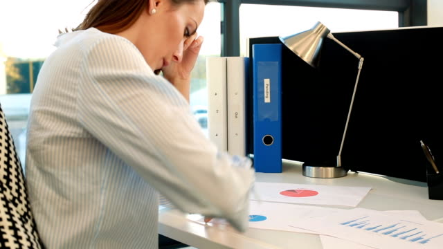 woman at her desk working - office cubicle stock videos & royalty-free footage