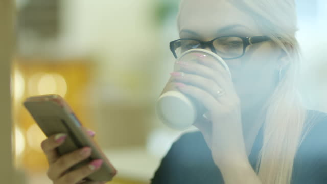 Woman at Reading Mails on Phone in Caffee video