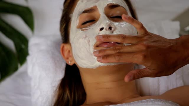 Woman at spa getting facial treatment video