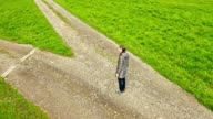 istock Woman at the crossroad. Symbol of choice. 1220396003