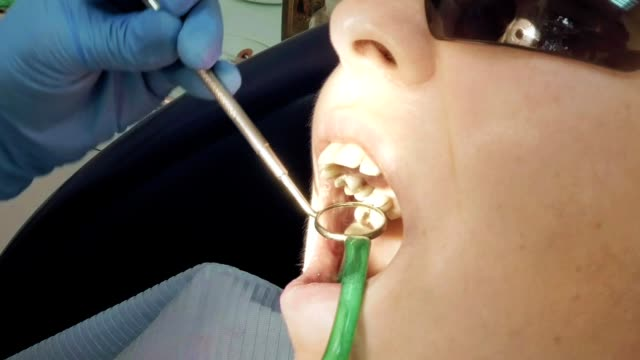Woman at the dentist medical clinic for treatment video