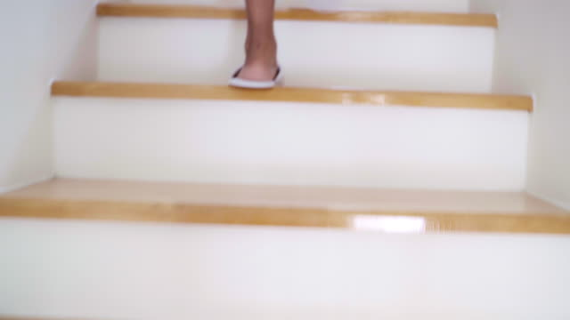 Woman Barefoot Step Walking Up Stairs in Home.