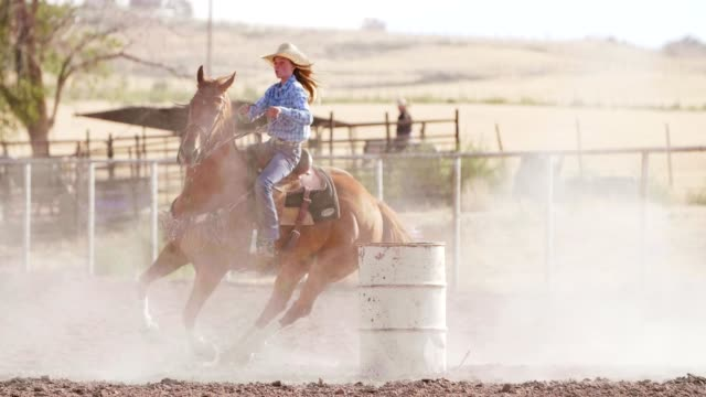 woman barrel racing at rodeo. - rodeo stock videos and b-roll footage
