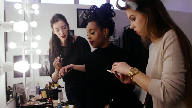 Woman beauty blogger looking professional cosmetics in makeup room video