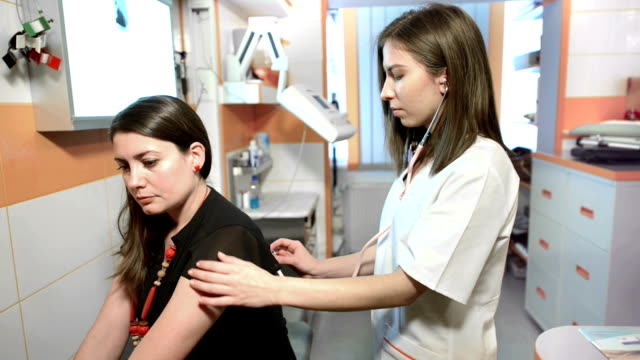 woman being consulted by doctor - ассистент стоковые видео и кадры b-roll