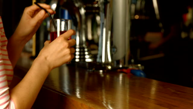 Woman being served drink at the bar video