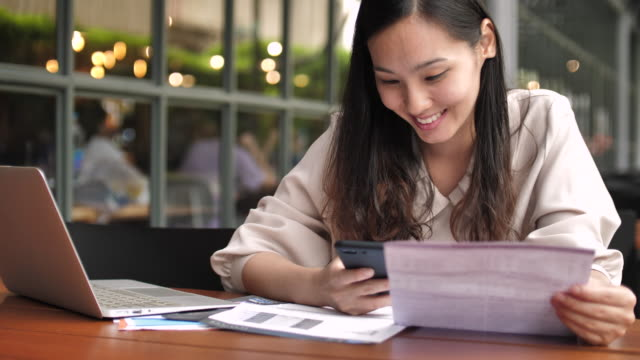 Woman Bill Payment with mobile phone
