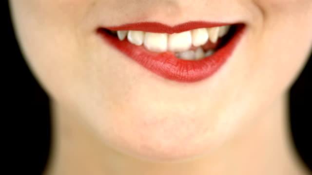 hd: frau ihre lippen beißen - lippen stock-videos und b-roll-filmmaterial