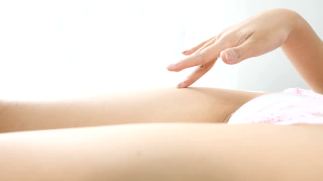 Woman body Finger moving on woman body, healthcare and skincare and spa concepts. spa treatment stock videos & royalty-free footage