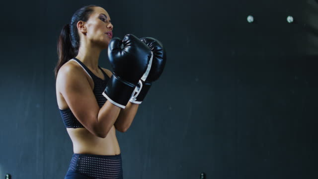 woman boxing in the gym - kick boxing video stock e b–roll