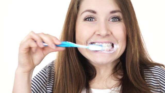 Woman brushing cleaning teeth 4K video